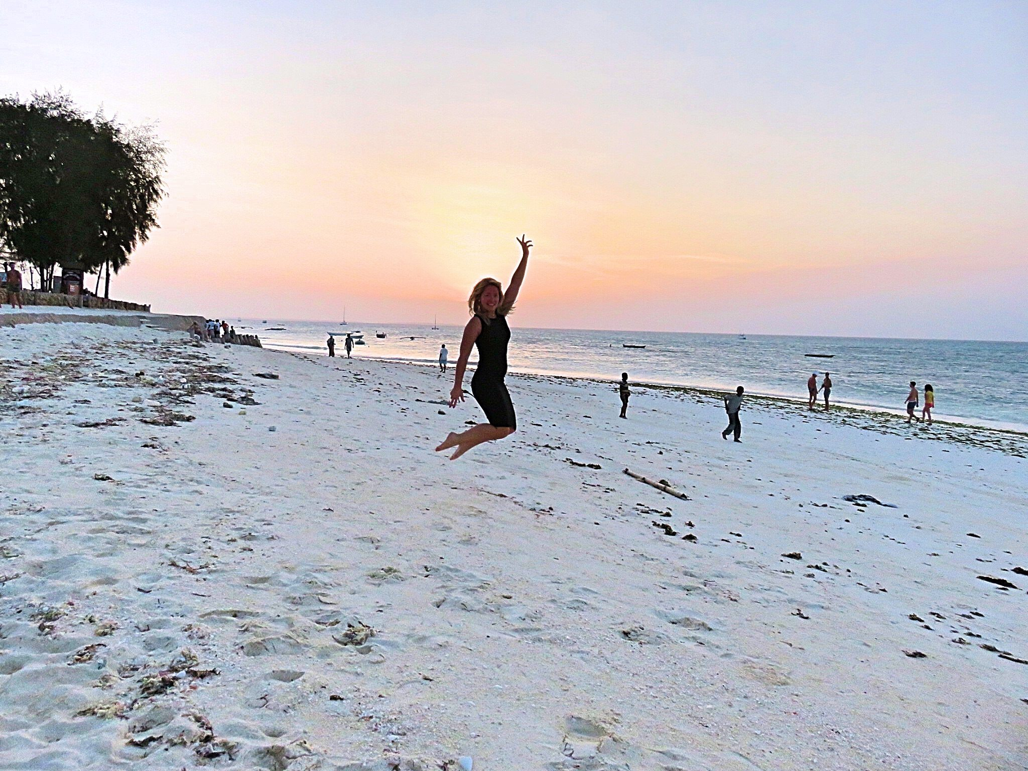 A picture f jumping in the air on the beach outside Smiles beach hotel