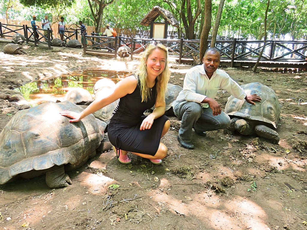 a picture of me with the caretaker of tortoises