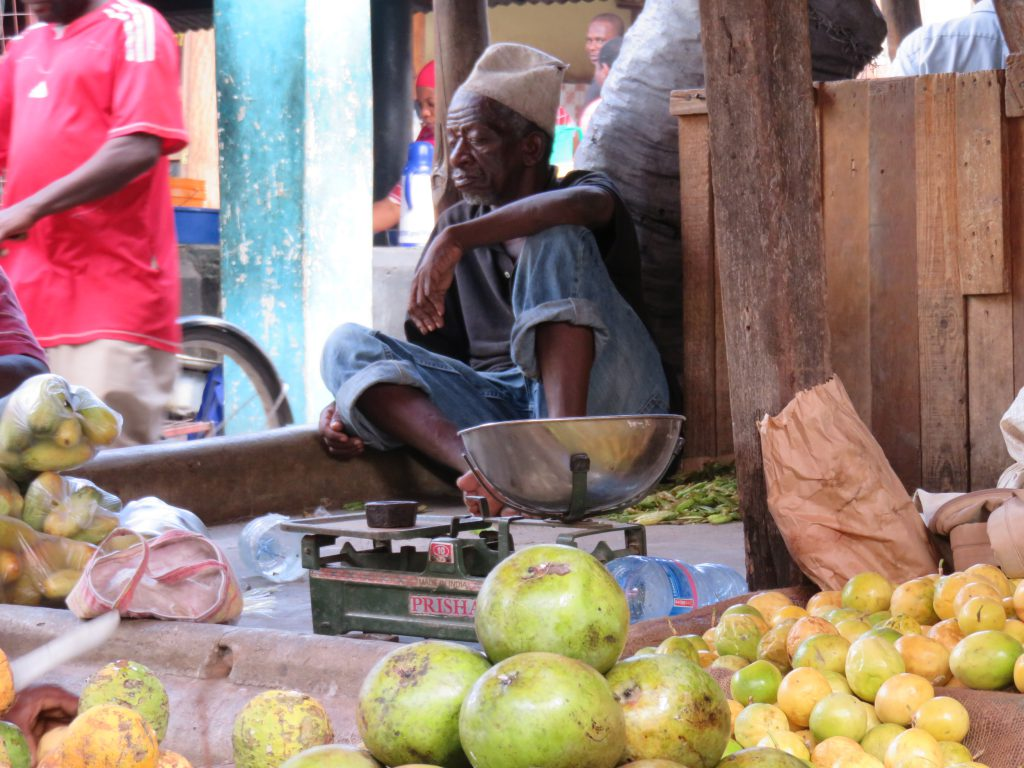 a fruit seller in his stall