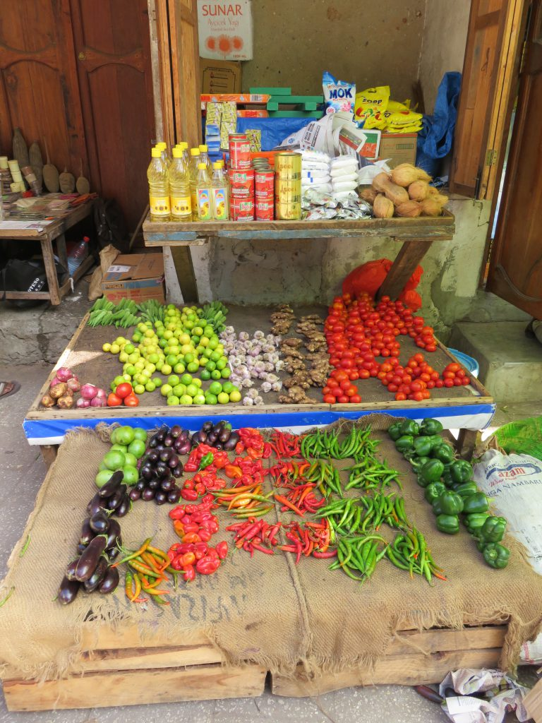 a small grocery shop with vegetables