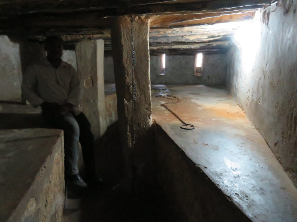 guide showing the chambers were they used to hold slaves