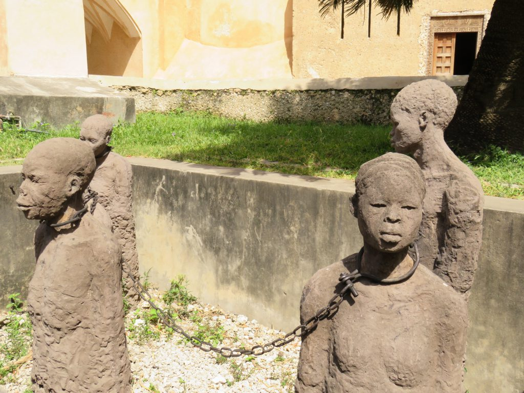 sculpture of slaves in chains