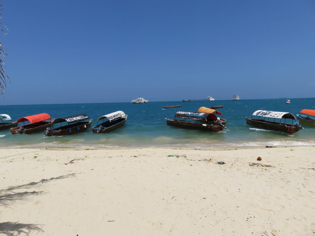 a picture of boat taxi on the beach