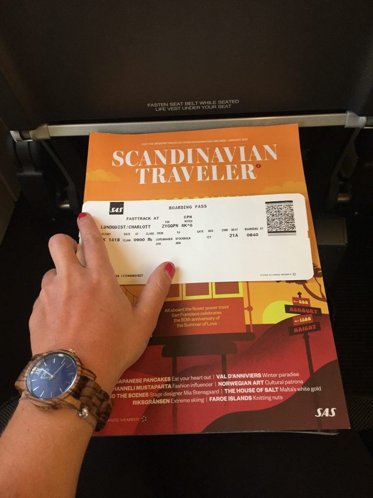 a picture of my boarding pass with the in flight magazine