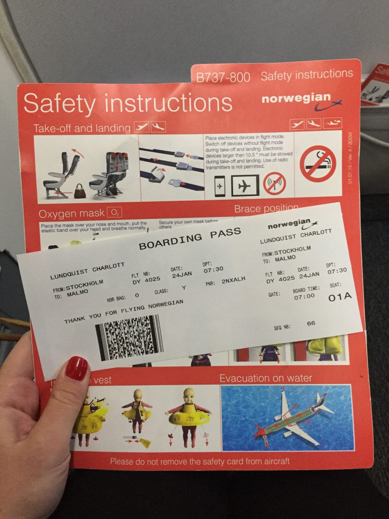 a picture of my boarding pass and safety card