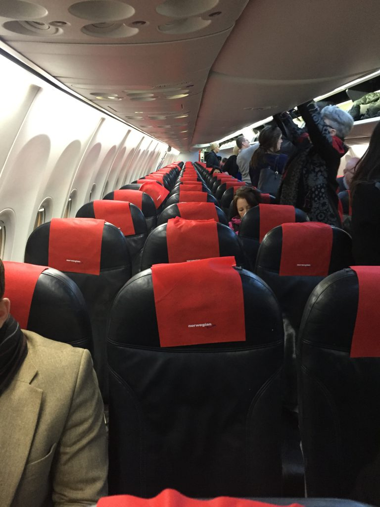 a picture of passengers getting off the plane