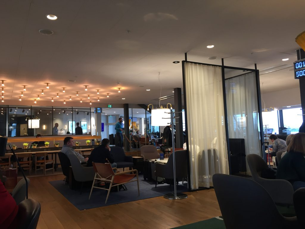 a picture of the lounge with other travellers seated