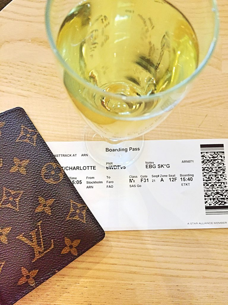 a picture of my boarding pass with a glass of champagne