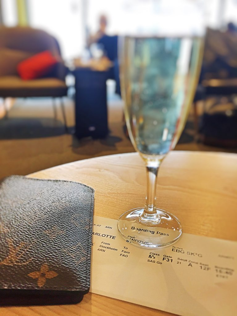 another picture of my boarding pass with a glass of champagne