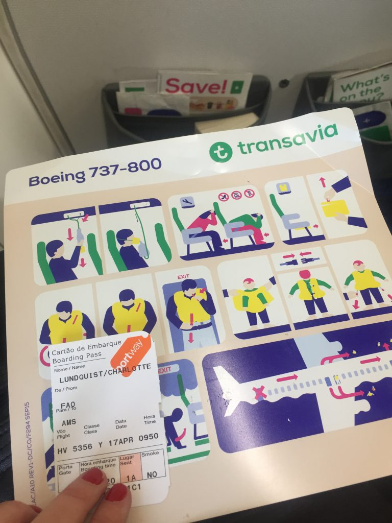 a picture of my boarding pass and safety card of transavia airlines
