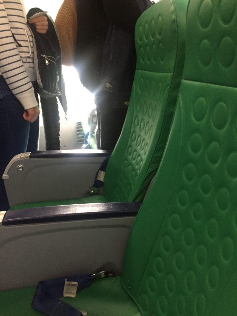 a picture of designer green seats on the airplane
