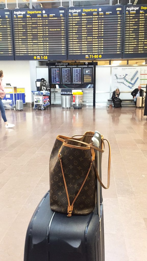 a picture of my bags at the departure terminal in stockholm