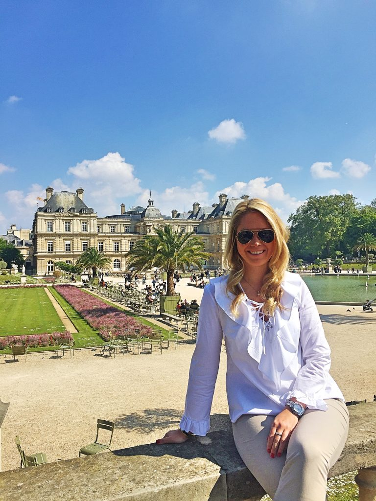 a picture of me with the Jardin du Luxembourg garden in the background