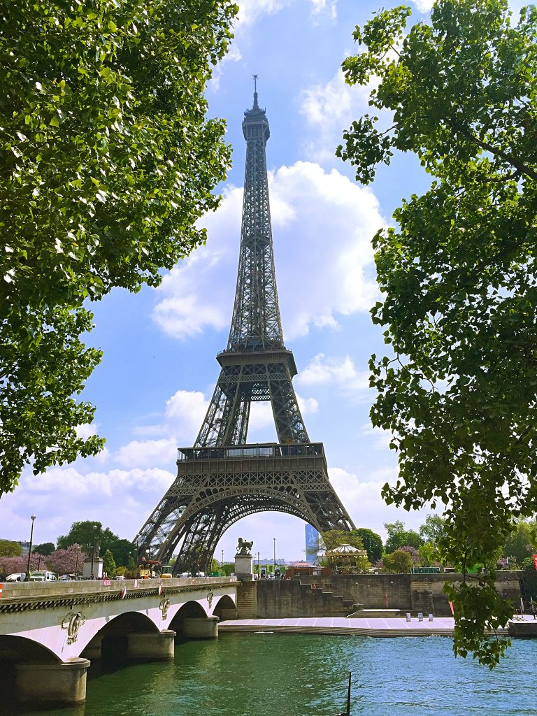 a picture of Eiffel tower across the bridge