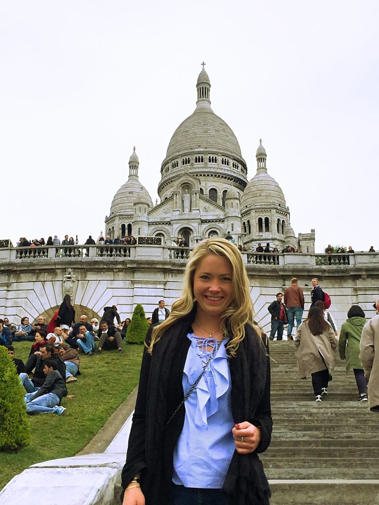 a picture of me on the stairs of Sacré Coeur