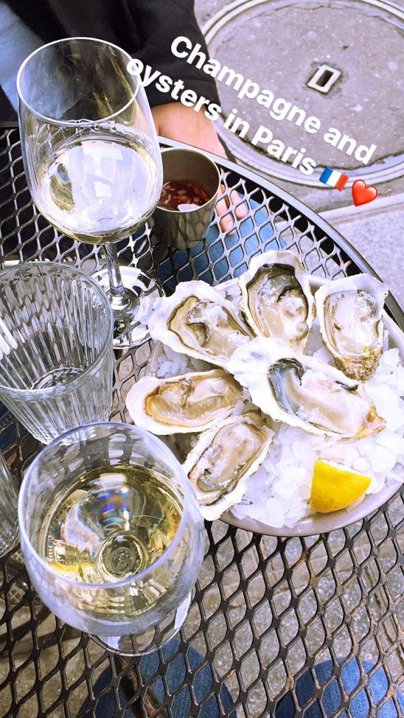 a picture of champagne and oysters at my table