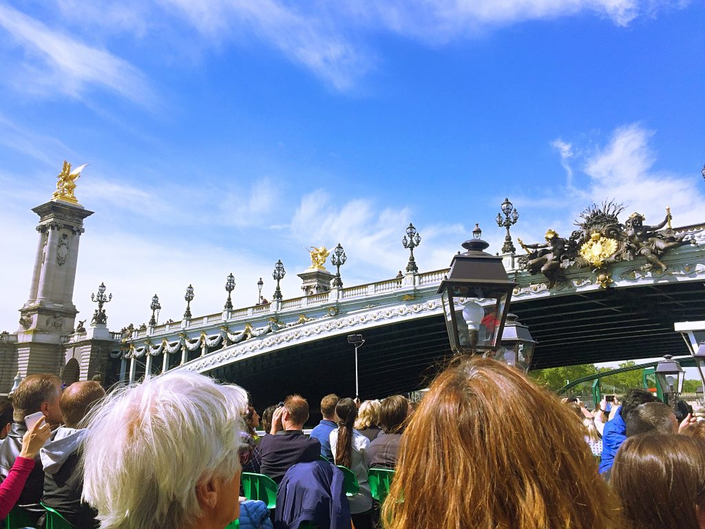a picture of tourists on the sightseeing boat on the river Seine