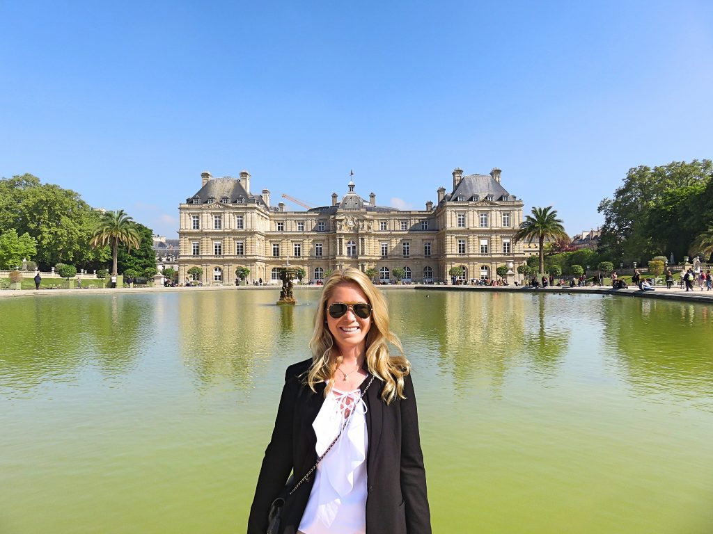 a picture of me in front of the pond at Jardin du Luxembourg garden