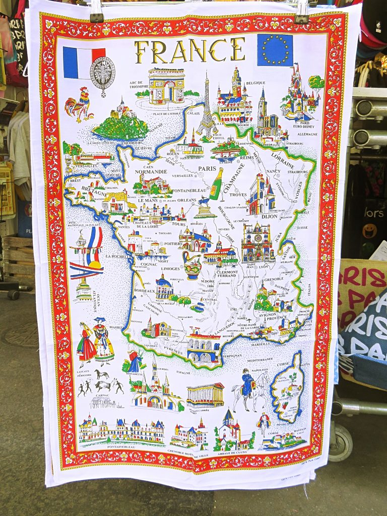 a picture of a cloth map souvenir on a street in paris