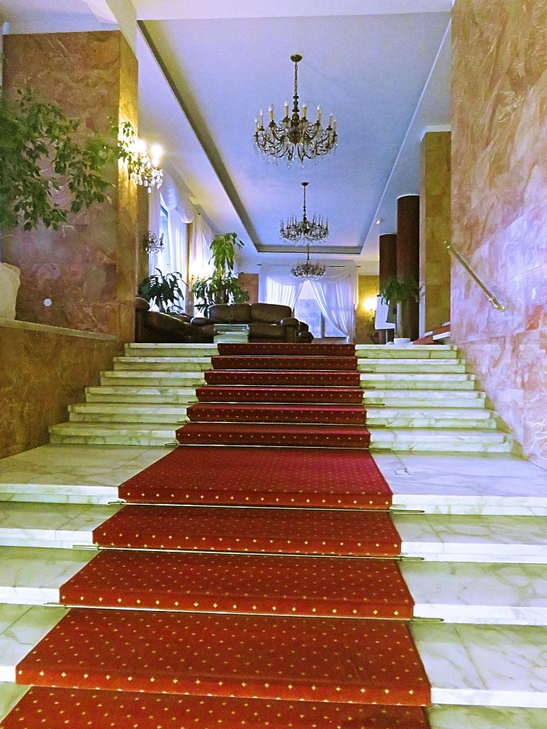a picture of stairs and lobby at the hotel