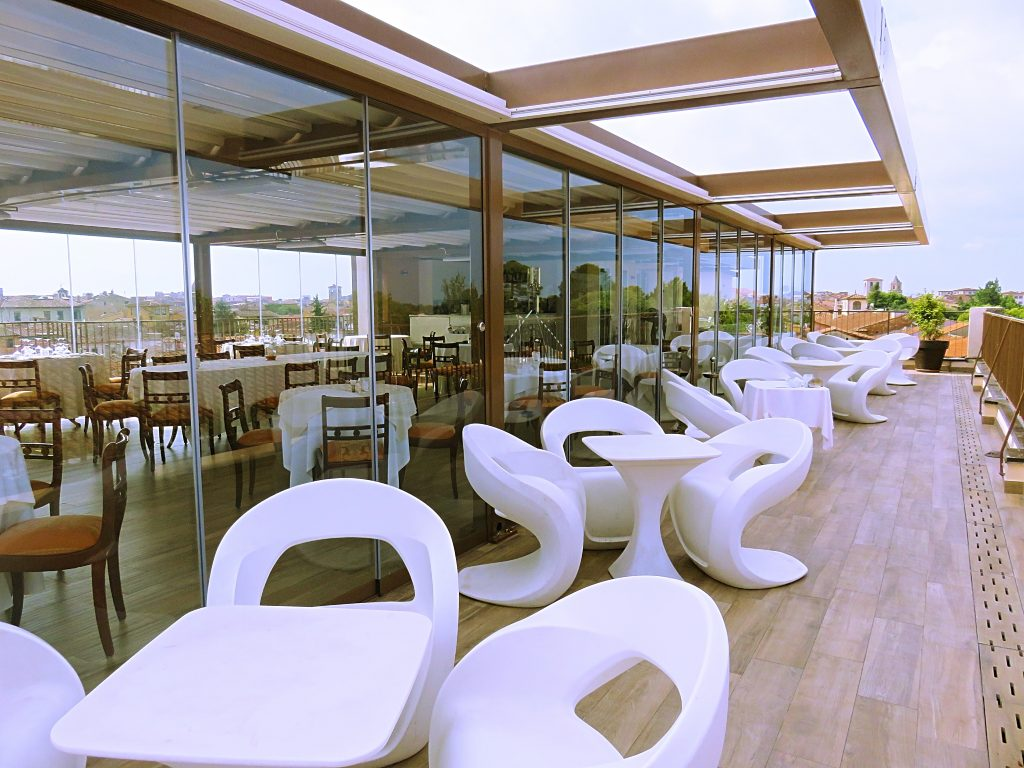 a picture of designer chairs in the rooftop restaurant