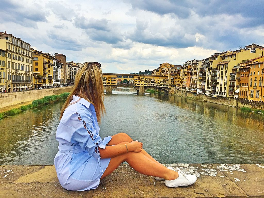 A picture of me sitting on a bridge looking at Ponte Veccio