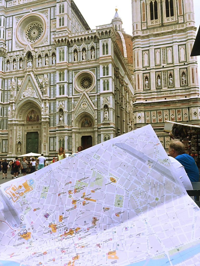 A picture of me holding a map outside the Cattedrale di S.Maria del Fiore