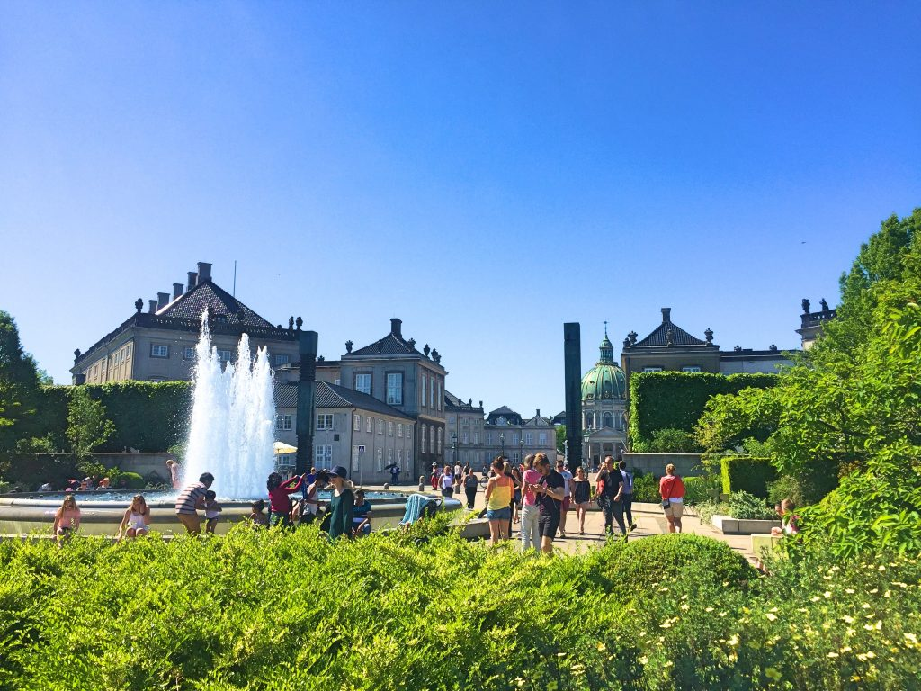 A picture of tourists taking photos beside the fountain