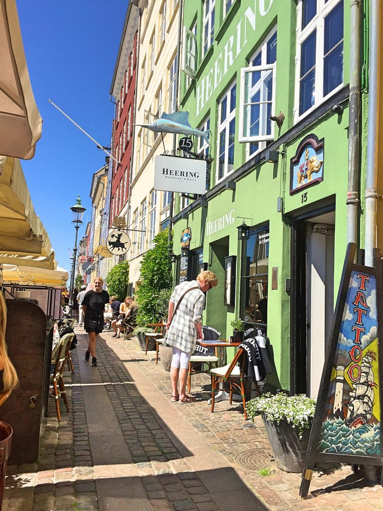 A picture of tourists walking on a charming street