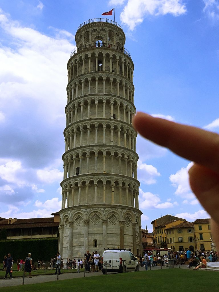 a picture of my finger pointing at the tower