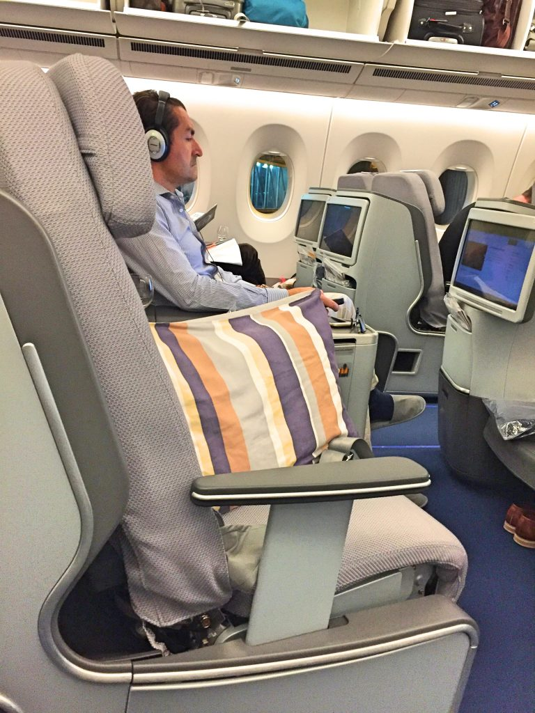 A picture of my co passenger watching something on his screen