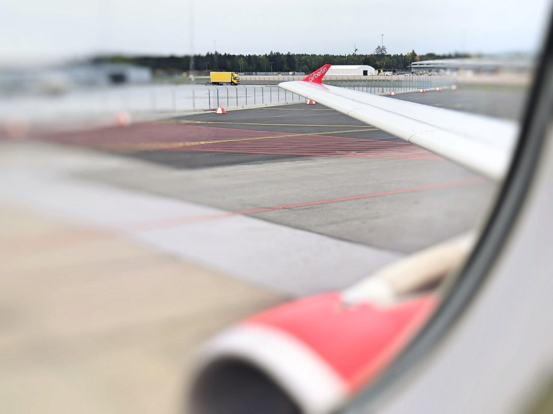 A view from the window when the plane during taxi