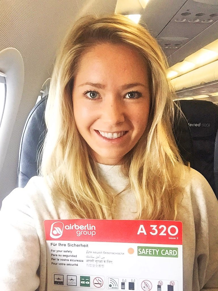 A picture of me holding the safety card in the plane