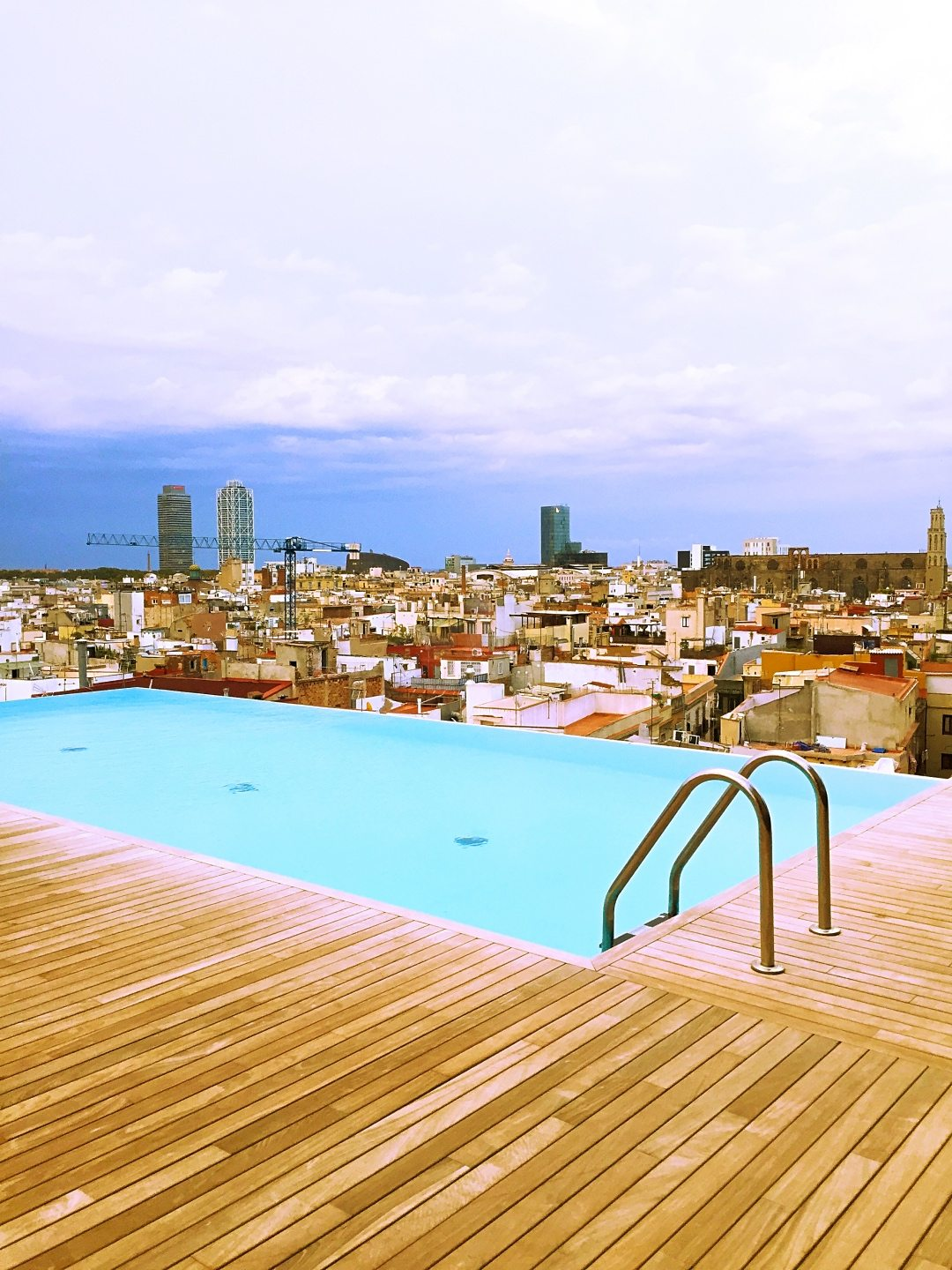 A picture of the infinity pool with a view of the city